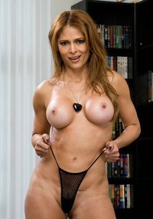 Busty latina Monique Fuentes showing off her shapely mature body