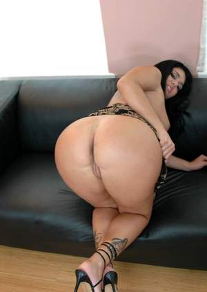 Curvaceous latina Olivia OLovely exposing round butt and shaved slit