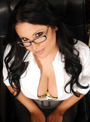 Busty latina teacher in glasses strips and teases her shaved slit