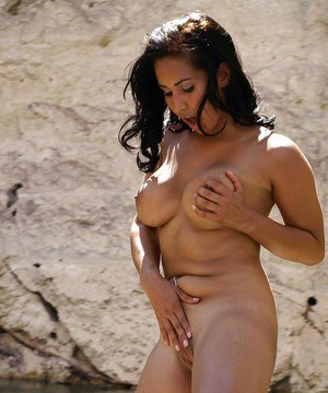 Latina pornstar babe Isis Love stripping outdoor and swimming naked
