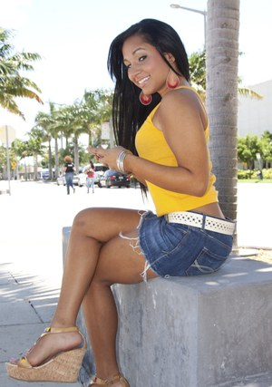 Latin babe with long legs Kim Kennedy shows her ass upskirt