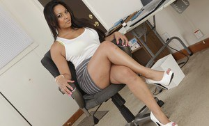 Sultry latina Adriana Luna takes off dress and lingerie in the office
