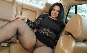 Plump latin MILF posing in sexy stockings with a bunny tail