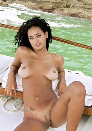 Latin hottie takes off bikini and exposes her tight curves on a boat