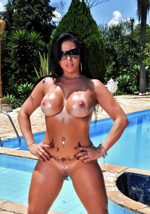 Latina MILF Julianna shows her big tits and shaved cunt near the pool