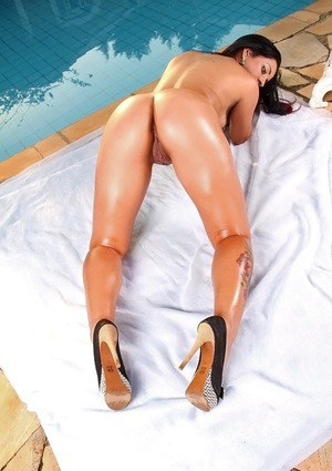 Tattooed latina Bia Teles caressing her oiled up curves at the poolside