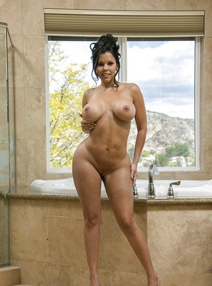 Gorgeous latina lassie Diamond Kitty taking off her lingerie and getting wet