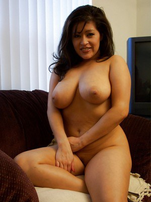 Saucy latina MILF with tempting curves undressing and caressing herself
