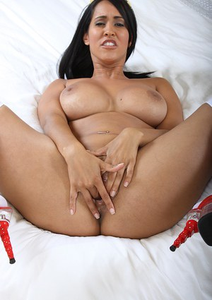 Latina MILF babe with huge tits enjoys fingering her wet pussy