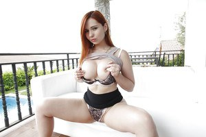 Sassy redhead hottie with ample ass and round tits slipping off her clothes