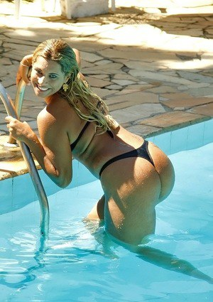 Envious Latina girl Manuelle swims in pool and spreads fudge tunnel