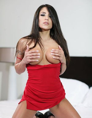 Playful latina temtress uncovering her gorgeous curves on the bed