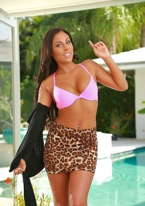 Latina babe Gianna undressing herself outdoor by the pool