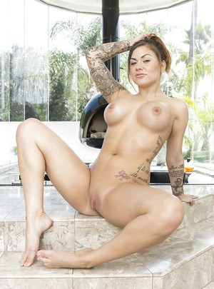 Tattooed mom Karmen Karma poses in her sexy jeans shorts and masturbates