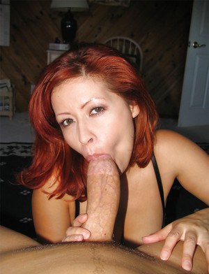 Milf with red hair is giving a blowjob and swallowing sperm load