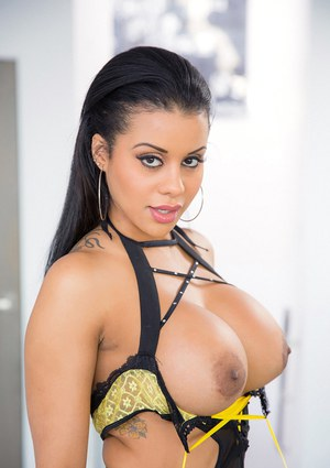 Tattooed Latina Mary Jean is posing in her sexy yellow lingerie