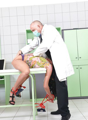 BDSM queen Anissa Kate gets her ass hole poked by two doctors tools