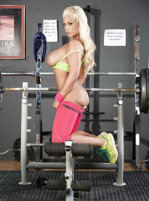 Latina pornstar Bridgette B lets her big hooters loose during workout