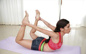 Hot brunette Latina Alex Tanner doing yoga in her tight shorts