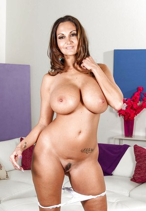 Buxom Latina wife Ava Addams poses fully clothed before stripping naked