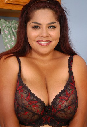 Fat Latina lady Nikko unleashes her big saggy boobs in the kitchen