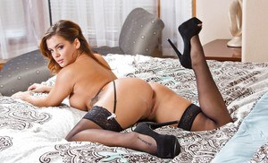 Latina hottie Keisha Grey spreading trimmed pussy in black stockings
