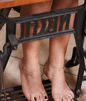 Sultry Latina model Sharon slips pretty barefeet out of ballerina slippers