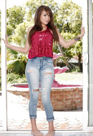 Latina teenager Cassidy Banks posing fully clothed outdoors in ripped jeans