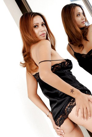 Cute Latina first timer Esther modeling in black silk nightie