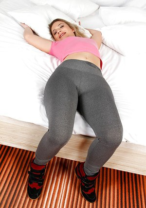 Sexy Latina chick Flavia Oliveira removes yoga pants to masturbate pussy