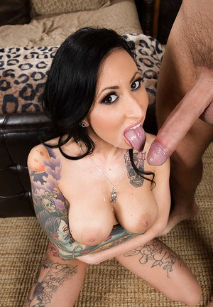 Heavily tattooed brunette Latina Lily Lane coaxing cumshot from big cock