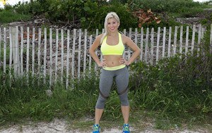 Blonde babe Cristi Ann models outdoors in yoga pants during sports workout