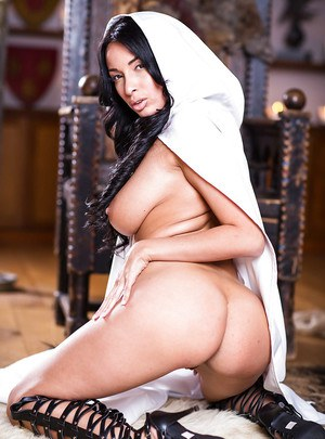 Brunette Latina babe Anissa Kate flaunting massive juggs in boots