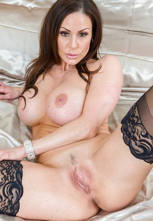 Brunette mom Kendra Lust revealing large tits during babe photo shoot