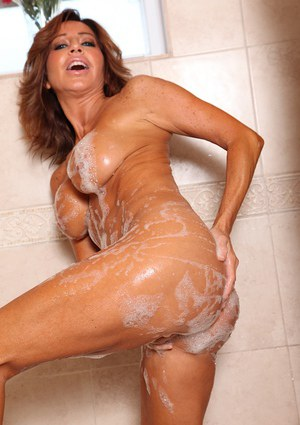 Latina babe Tara Holiday flaunting large oiled MILF juggs in bathroom