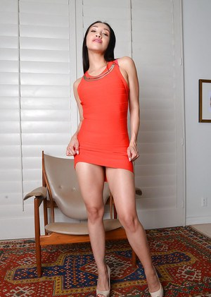 Latina MILF pornstar Vicki Chase showing off great legs and and hairy muff