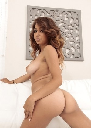 Latina solo girl Sarai unharnessing her large all natural boobs