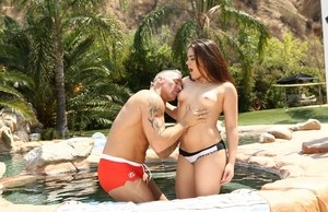 Petite Latina Kimber Woods gets nailed hard by an older guy by pool