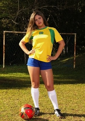 Latina female soccer player shows off her big ass in knees socks on field
