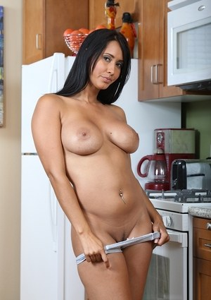 Isis loves touching her moist pussy while alone in the kitchen in a great solo