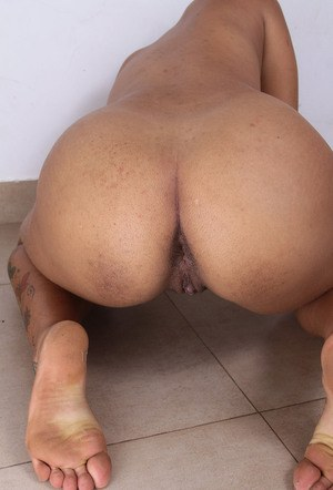 Exotic Latina girl makes her nude modeling debut in bare feet