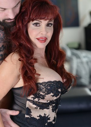 Mature redhead pornstar Sexy Vanessa gets fucked by a younger stud