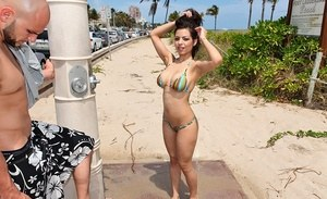 Latina female Yurizan Beltran takes off her bikini down at the beach
