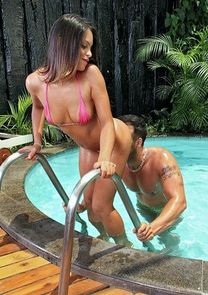 Latina chick gives her swimming instructor a blowjob to pay for her lesson